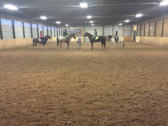 Riders is group lesson - instructor Laura Fay